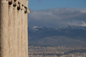 Athens and hills seen beyond Erechtheion colonnade