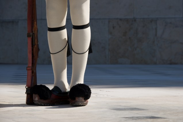 Legs and rifle of Greek presidential guardsman