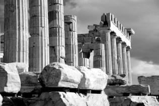 Mono piles of stones before ruined Parthenon