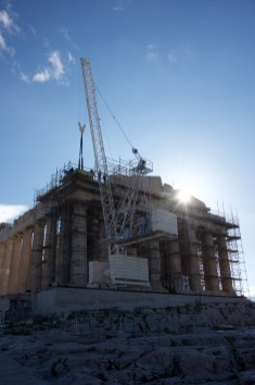 Sun rising behind Parthenon crane and scaffolding