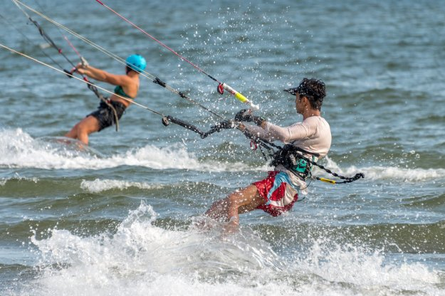Two kite surfers with lots of spray