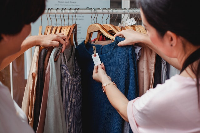 Image of two ladies shopping. Impulse shopping is a habit that keeps you broke.