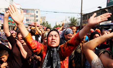 Uighur people take to the streets in Urumqi. Photograph: Guang Niu/Getty Images