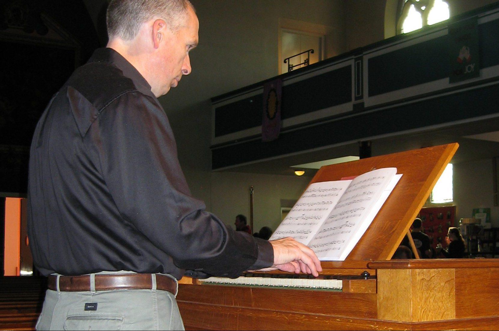 Nick Houghton organist, playing his Goetze & Gwynn chamber organ