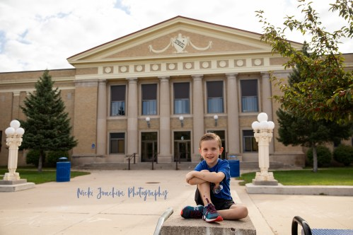 smiling boy wearing blue in child portrait by MN family and child photographer Nicki Joachim Photography of Owatonna Minnesota