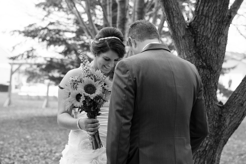 Bride and groom first look at outdoor rustic wedding portrait in Kasson MN by MN Wedding Photographer Nicki Joachim Photography of Owatonna Minnesota