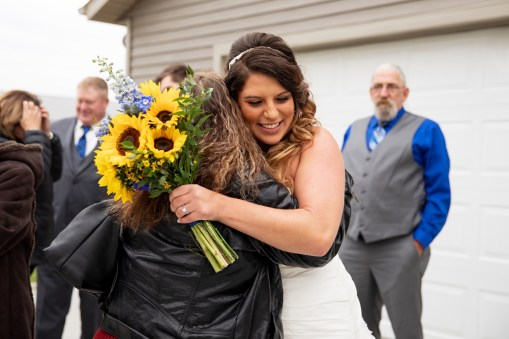 Bride celebrating at rustic outdoor country wedding in Kasson MN by MN Photographer Nicki Joachim Photography of Owatonna, Minnesota