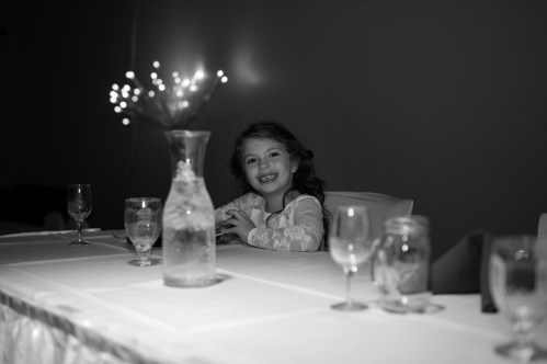 Flower girl at rustic country chic wedding repcetion in Kasson MN by MN Wedding Photographer Nicki Joachim Photography of Owatonna, Minnesota