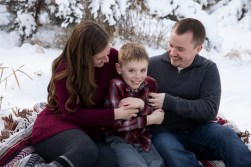 Outdoor winter lifestyle family portrait in the snow by MN Family Photographer Nicki Joachim Photography of Owatonna, Minnesota