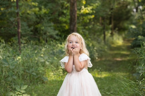 young girl in dollcake dress in outdoor princess session in a beautiful child portrait by MN Family Photographer Nicki Joachim Photography of Owatonna Minnesota