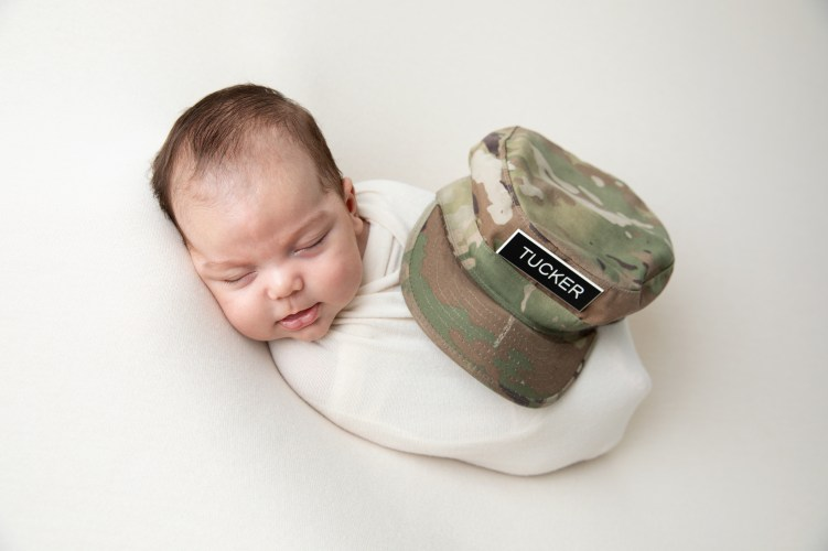 newborn baby boy wrapped in ivory with army soldier hat in an adorable patriotic infant portait by MN Newborn Photographer Nicki Joachim Photograhy