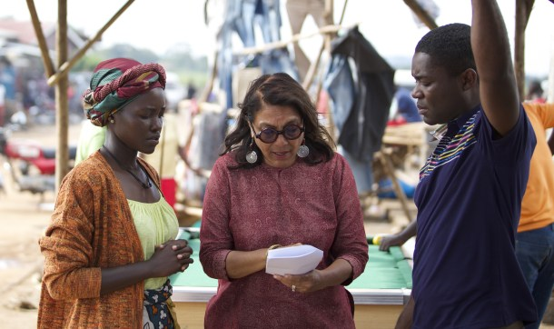 Director Mira Nair on the set of Disney's QUEEN OF KATWE iwith David Oyelowo and Lupita Nyong'o.  The vibrant true story of a young girl from the streets of rural Uganda whose world changes when she is introduced to the game of chess, the film also stars newcomer Madina Nalwanga.