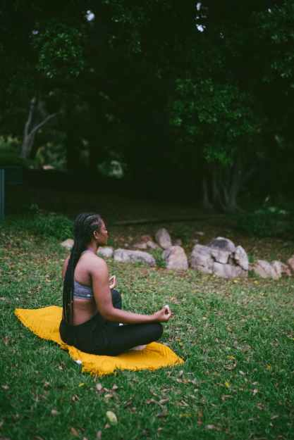 photo of woman doing meditation