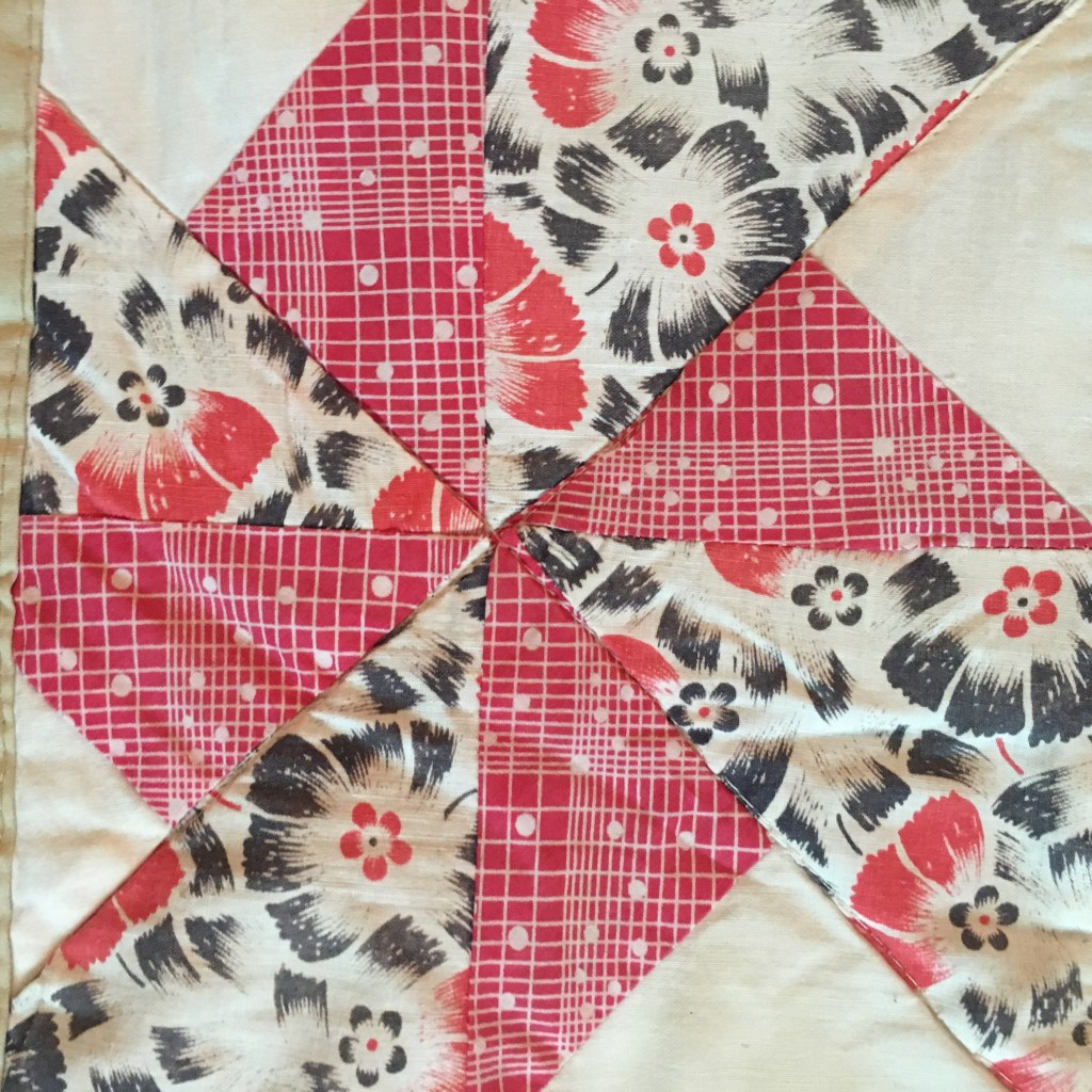 double pinwheel quilt block with vintage fabrics