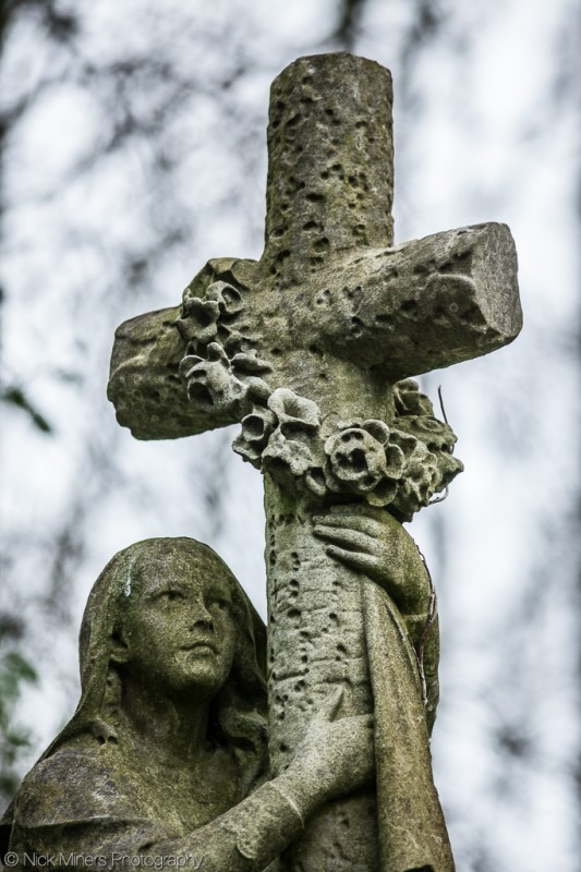 Highgate cemetery is full of tombstones, trees and statues. Cropping in on one of the statues, and blurring out the background, keeps the composition simple.