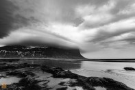 The enormous Lómagnúpur cliff is engulfed by cloud