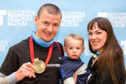A runner in the 2016 London Marathon with his proud family
