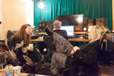 Curver Thoroddsen works on finalising the mix for Friday's listening party as Kata and Alexandra Baldursdóttir (guitar) relax
