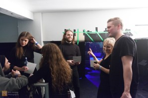 The band prepare to go on stage