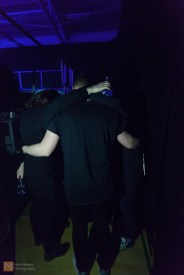 Immediately before going on stage, the band huddle together