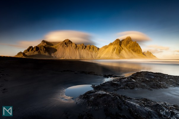 Vestrahorn mountain in South Eastern Iceland, seen from Stokksnes beach, lit by the setting sun. Click image to buy a copy