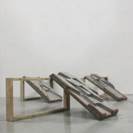 """""""Positives (from 'Adding Up'),"""" 2015, concrete and wood, 120 x 120 x 30 cm."""