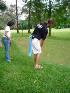 Teaching young girl golf swing