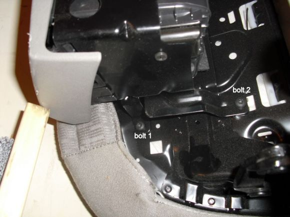 Bolts to remove the storage compartment under the seat