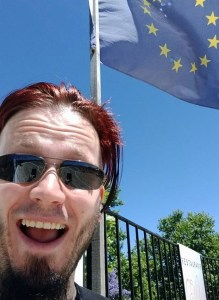 Nick Sheridan stands in front of an EU Flag, Winnie The Pooh Brexit Meme, EU Referendum