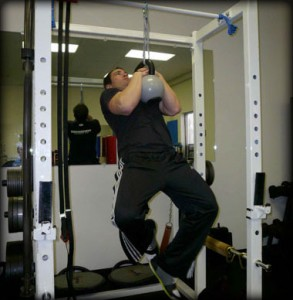 """I first wrote about the Kettlebell Clinch Pull-Up in 2009 as an example of a """"Specific"""" exercise application for improving Muay Thai Clinch strength. The force production patterns and joint angles in this exercise more closely match those of the clinch (aka. The Plum Position) than does the general Pull Up or Chin-Up."""