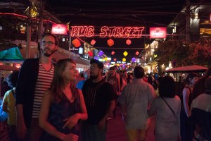 Tourists navigate a packed Pub Street