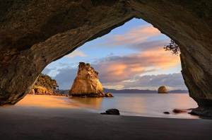 Sunrise at Cathedral cove New Zealand by Nico Babot