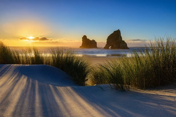 Sunset at Wharariki beach in New Zealand photo by Nico Babot
