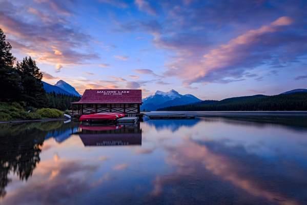 Sunrise on Maligne lake boat shed Canada photo by Nico Babot