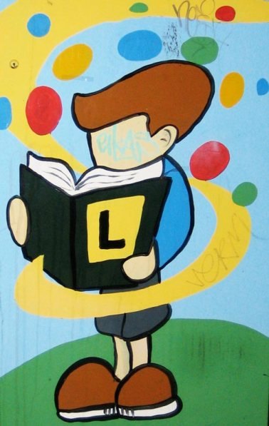 Street Art: Boy Reading Book
