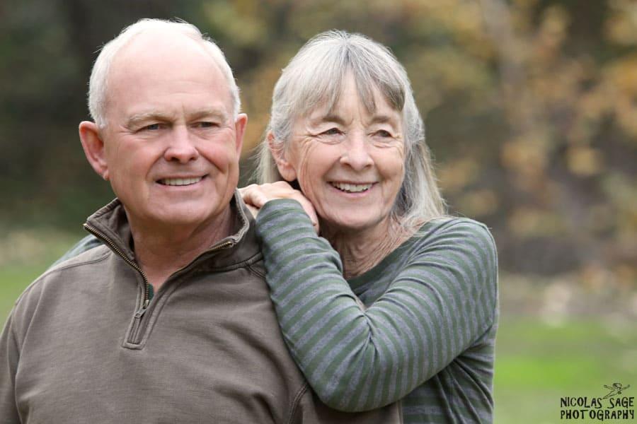 older couple portrait outdoors at park