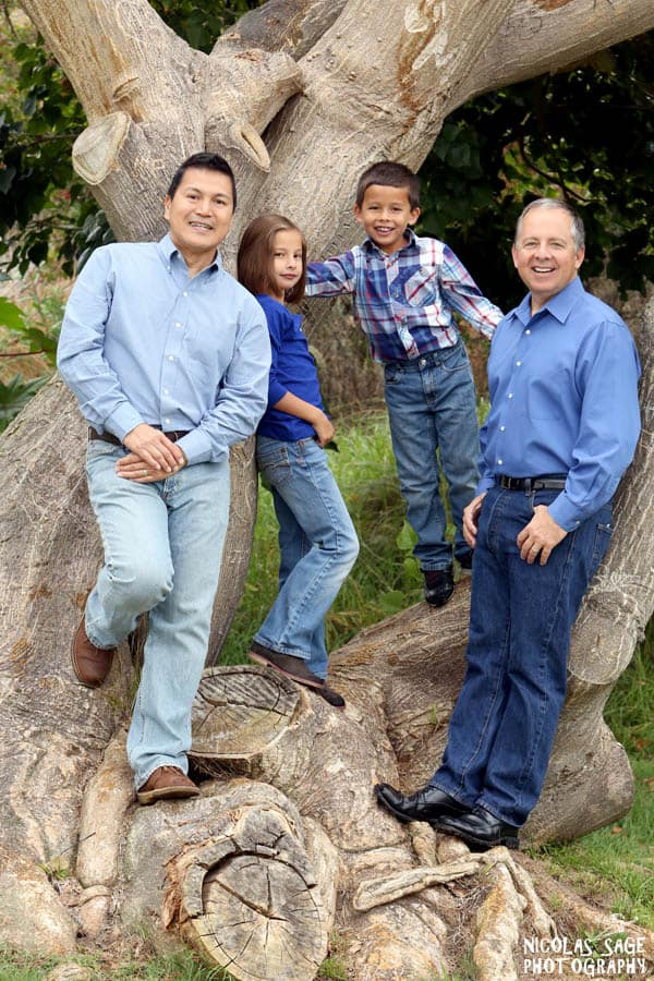 outdoor gay family portrait by a tree