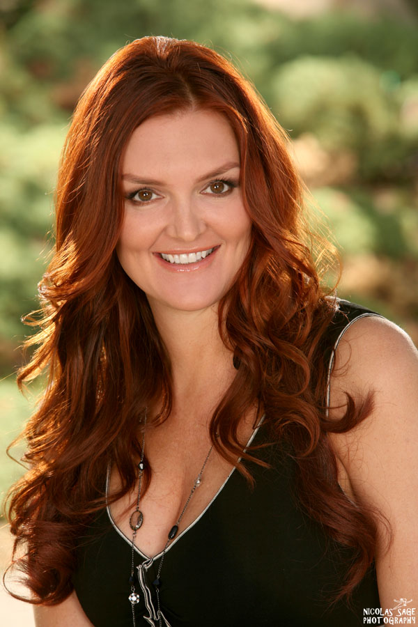 outdoor business headshot in Los Angeles of a woman with red hair