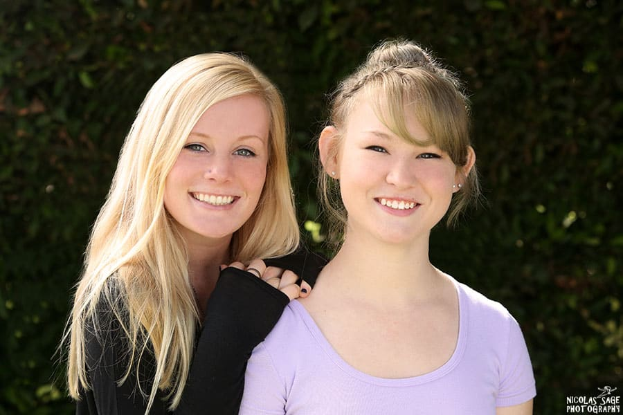 two teen-aged sisters posing for a family portrait in West Los Angeles.