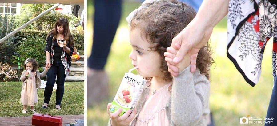 child drinking honest juice box