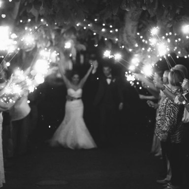 French Estate wedding photographer orange sparkler send off