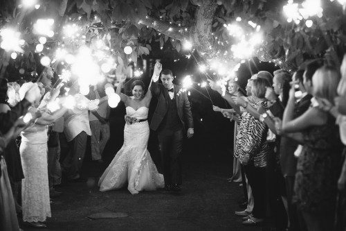 French estate wedding photographer orange reception sparkler exit