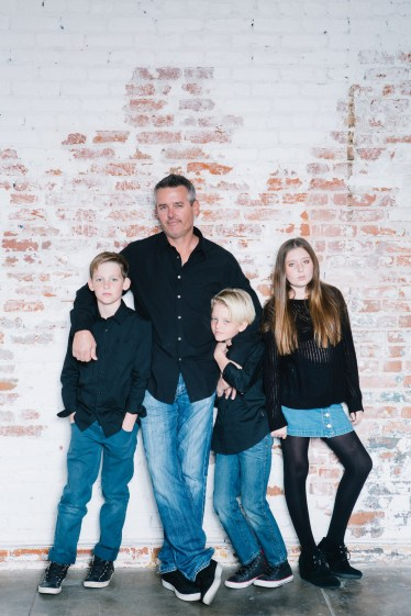 family photography ideas in the studio nicole caldwell brick backdrop 08