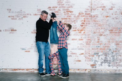 family photography ideas in the studio nicole caldwell brick backdrop 15