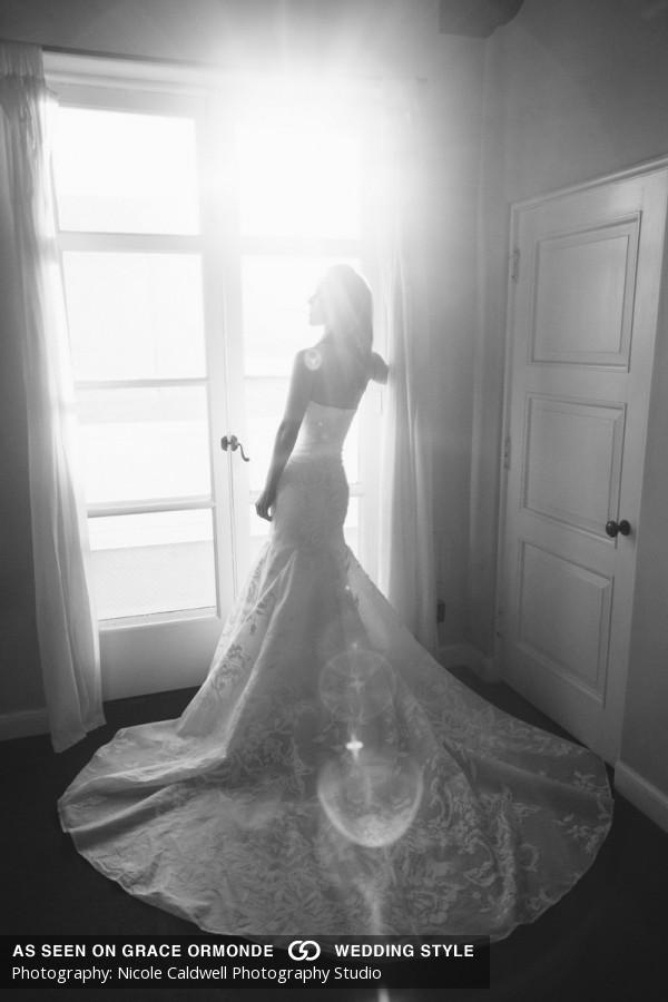 bride in window vibiana wedding
