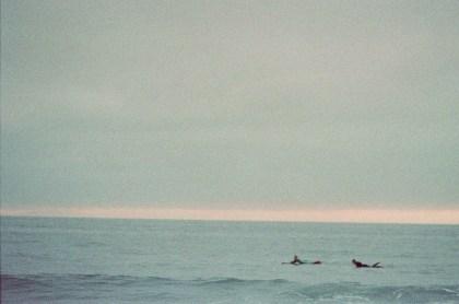 surf couple engagement photos on beach film