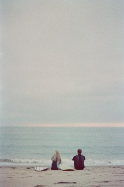 crystal cove surf couple engagement photos on beach film