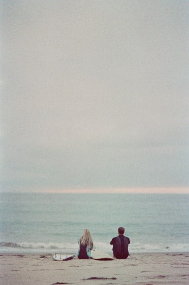 crystal cove surf couple engagement photos on beach film