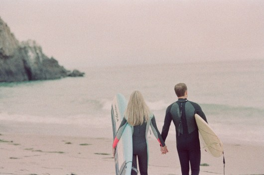 surf couple engagement photos on beach film laguna beach