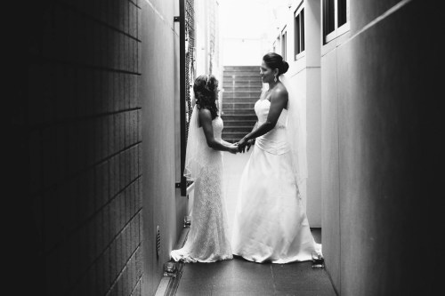 brides in hallway 7 degrees gay wedding